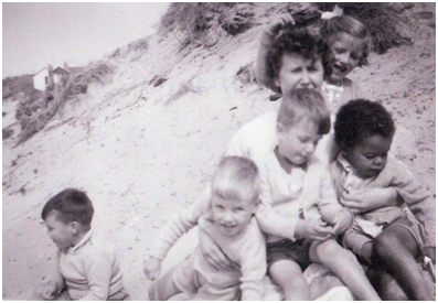 Group of children from orphanage including David Divine (pictured right) and carer.